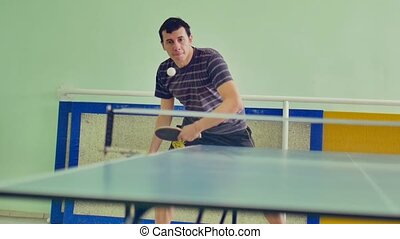 man playing table tennis slow motion sport video backhand -...
