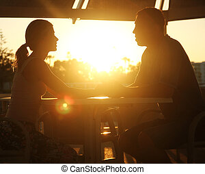 silhouette of couple in love at sunset