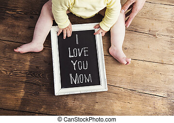 Mothers day composition Picture frame Wooden background...