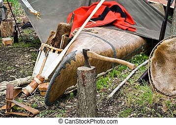 Campsite - Axe stuck in tree stump at Indian campsite.
