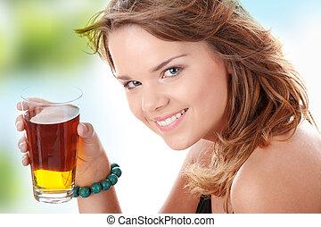 Young woman in bikini drinking ice tea isolated