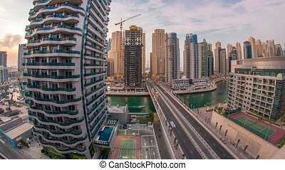 An Aerial view of Dubai Marina Towers in Dubai day to night timelapse