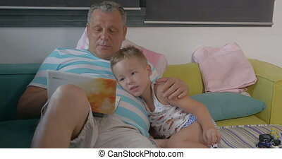 Grandfather and grandchild with laptop at home