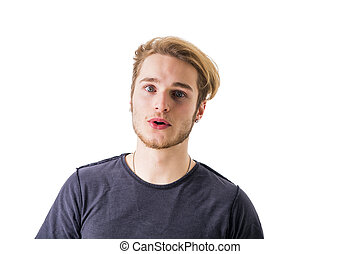 Puzzled man with unsure expression - Confused young blond...
