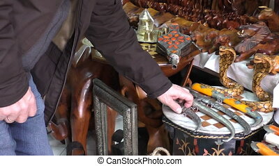 Man choosing Moroccan dagger - Tourist looking at Moroccan...