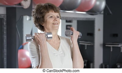 Senior woman lifting dumbbells, mature, fitness