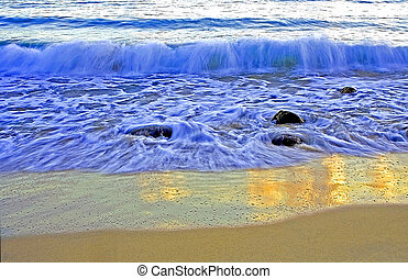 Wave Breaking on Beach - Wave breaking on Noosa Beach at...