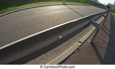 Separating fence on road - Metal fencing along highway...