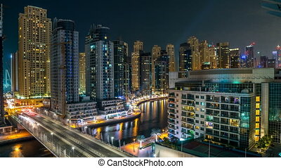 Dubai Marina at night timelapse with light trails of boats...