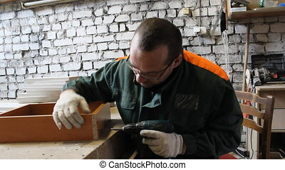 Man produces cabinet furniture
