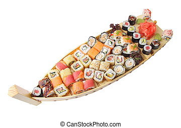 wooden ship with sushi and rolls - wooden ship with...