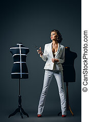 haute couture - Portrait of a stylish woman fashion designer...