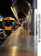 Underground Train Station - A train parked in an underground...