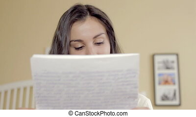 Young girl reading a letter and smiling