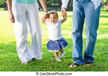 family walk - a family walking together in park holding...