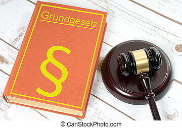 Statute book with the German words fundamental law and...