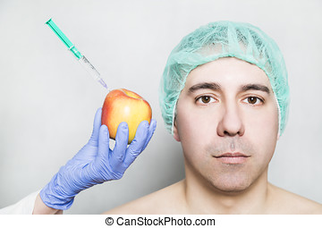 Doctor aesthetician makes beauty injections to apple near...
