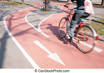 Bicyclist Riding On A Bike Path - A male bicyclist is riding...