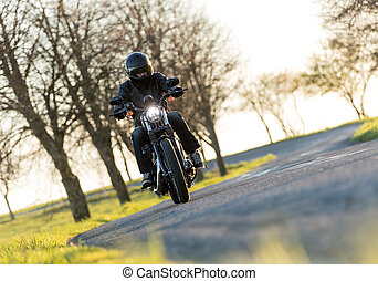 Man seat on the motorcycle on the forest road - Man seat on...