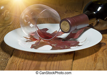 unfinished spilled wine on old autumn leaf