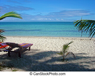 Concept View of Paradise, Fiji - An empty lounger with a...