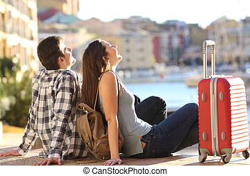 Couple of tourists enjoying vacations - Side view of a...
