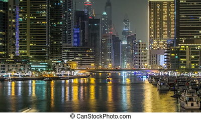 Promenade and canal in Dubai Marina timelapse at night, UAE....
