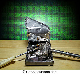 broken the hard drive from the computer in the background of...