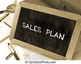 Sales Plan Handwritten on Chalkboard. Composition with Small...