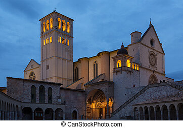 Famous Basilica of Saint Francis of Assisi with Lower Plazain night. Assisi, Umbria, Italy