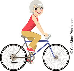 Senior Woman Riding - Beautiful senior woman riding bicycle...