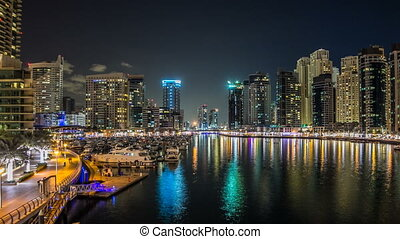 View of Dubai Marina Towers and yahct in Dubai at night timelapse hyperlapse