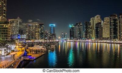 View of Dubai Marina Towers and yahct in Dubai at night...