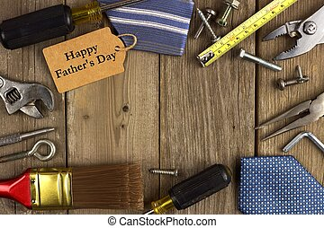 Happy Fathers Day gift tag with frame of tools and ties on...