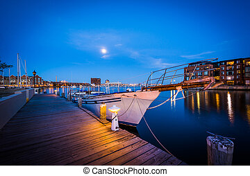 Boats in a marina at twilight, in Fells Point, Baltimore, Maryland.