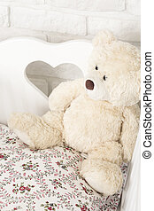 Babies' favourite toy - Shot of a white teddy bear in a crib