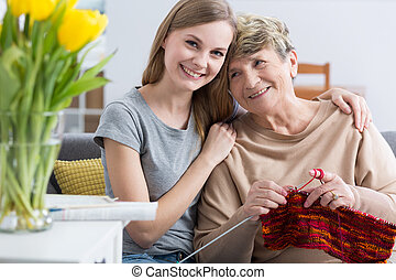 I love you grandma very much! - Young girl embracing her...