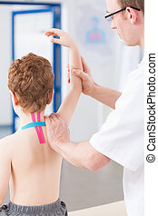 Long process of rehabilitation - Boy with shoulder and neck...
