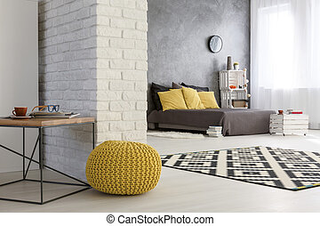 Modern falt with decorative brick wall - Light interior with...