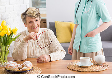 With my carer i feel safe - Happy senior woman sitting...