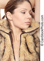 Woman in fur - Close up portrait of young beautiful woman in...