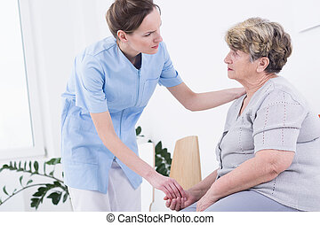 Nursing home care pensioner and her carer