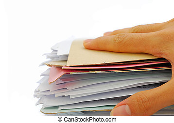 Hand holding stack of files - Hand on a stack of files full...