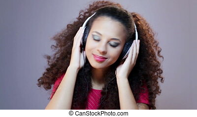 Music is a part of my world - Woman head shaking, listening...