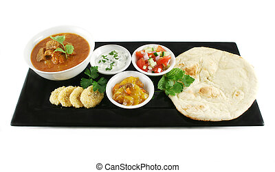 Indian Feast - Indian feast of vindaloo curry, naan bread,...