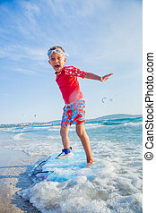 Young boy learning to surf