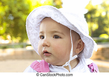 Baby protected by hat - 12 age old baby girl protected by...