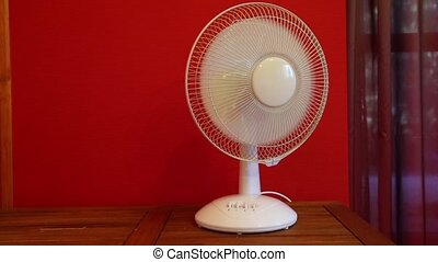 Electric table fan - Rotating electric fan in a room