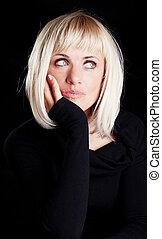 beautiful blond thoughtful woman