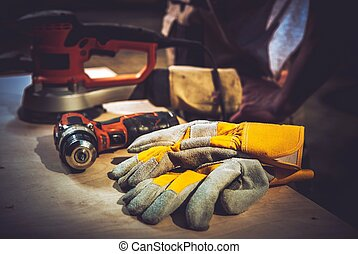 Home Remodeling Works Construction Tools and Safety Gloves